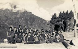"""Mount Everest Center students at Lawudo Retreat Center, Nepal, 1973. Lama Yeshe sent photos of the MEC students all around the world and also took photos with him on tour in an attempt to raise funds for them. """"Mummy"""" Max Mathews had a photo taken of each of them and had a group photo made into a poster. Photo by Nick Ribush."""