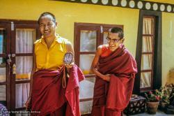 (39254_sl-3.psd) Lama Yeshe and Lama Zopa Rinpoche making Chenrezig tsa tsas on the rooftop at Kopan Monastery, 1973.