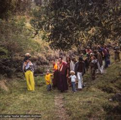 (39287_ng-3.TIF) Lama Yeshe and Lama Zopa Rinpoche walking with students from Diamond Valley to Eudlo land, 1974. Wendy Hobbs (photographer)