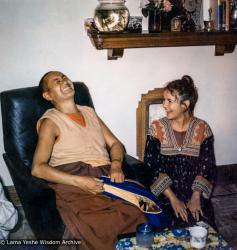 "(39289_pr-3.psd) Lama Yeshe and Gabe Wallace, Melbourne, 1974.  Gabe Wallace (donor). Pete Northend: ""I walked into our small flat and it was really crowded. Bea Ribush was there and Colin Crosbie, Pete and Gabe. It's a very small flat and you couldn't overlook anybody. So I stood there with the flagon under my arm while they all looked at me and packed up laughing. What I didn't know was that Lama Yeshe was sitting right beside me with his zen pulled over his face. Somehow that had made him invisible to me. Then he whipped it off. I couldn't believe he was there."""