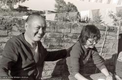 (39324_ng-3.tif) Lama Yeshe with Jampa Trinley's daughter, Tsen-la Tuladhar, Kopan Monastery, 1978.