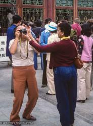 (39528_sl-3.jpg) Lama Yeshe holding camera with Max Mathews on vacation, China, 1982.