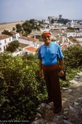 (39566_sl-3.jpg) Lama Yeshe in street clothes, rainbow visor, Lisbon, Portugal, 1983.