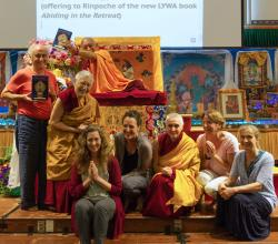 LYWA staff present Abiding in the Retreat book to Lama Zopa Rinpoche, North Carolina, 2017. Photo: Ven. Sherab.