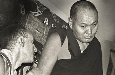Lama Yeshe giving a public talk at Kensington Town Hall, England, 1975. Nick Ribush is at the lower left.