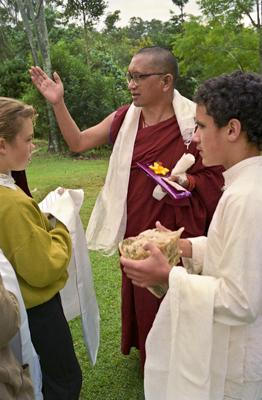 Lama Zopa Rinpoche with children at Chenrezig Institute, Australia, 1991. Photo: Thubten Yeshe (TY).