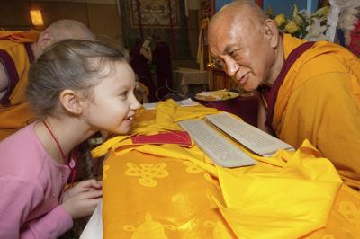 Lama Zopa Rinpoche with a young student, Maitripa College, USA, 2010. Photo: Marc Sakamoto.