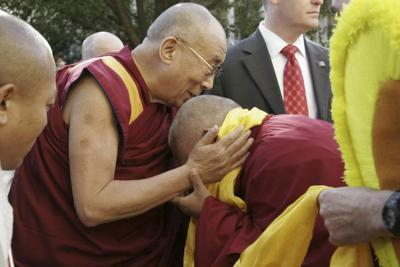 His Holiness the Dalai Lama being greeted by Lama Zopa Rinpoche at Kurukulla Center, Boston, 2012. Photo: Devin Jones.