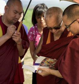 Lama Zopa Rinpoche signing books in Malaysia in 2016. Photo: Bill Kane.
