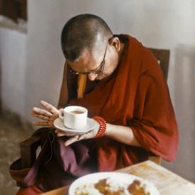 Lama Zopa Rinpoche blessing food as an offering to lepers, Bodhgaya, 1990. Photo by Andy Melnic.