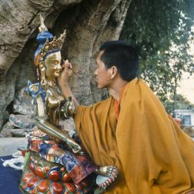 Lama Zopa Rinpoche painting a Tara statue, Kopan Monastery, Nepal, 1976. Photo: Peter Iseli.