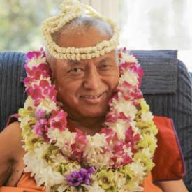 Lama Zopa Rinpoche with flower garlands, 2010.