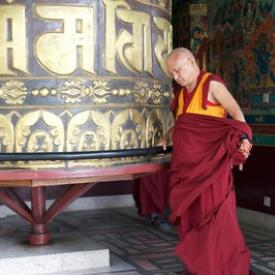 Lama Zopa Rinpoche turns the prayer wheel at Kopan Monastery, Nepal, December 2015. Photo: Bill Kane.