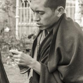 Lama Zopa Rinpoche doing puja, Manjushri Institute, England, 1979. Photo: Brian Beresford.