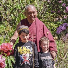 Lama Zopa Rinpoche with children at Chenrezig Institute, Australia, 1994.