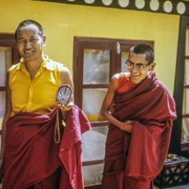 Lama Yeshe and Lama Zopa Rinpoche making Chenrezig tsa tsas on the rooftop terrace at Kopan Monastery, Nepal, 1973.