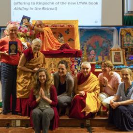 LYWA Staff presenting Abiding in the Retreat to Lama Zopa Rinpoche, North Carolina, 2017. Photo: Ven. Sherab.