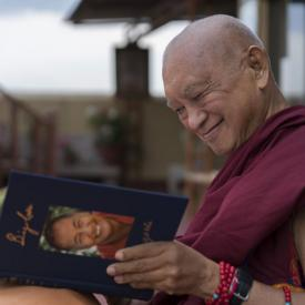 Lama Zopa Rinpoche enjoying his copy of Big Love, Kopan Monastery, Nepal, April 2020. Photo: Ven. Sherab.